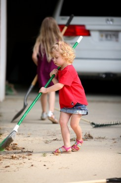 little girl sweeping