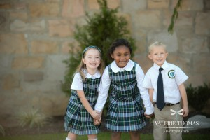 Photo of Catholic school children holding hands and smiling