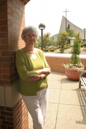 Photo of Barbara Morgan in front of the Christ the King Chapel at Franciscan University