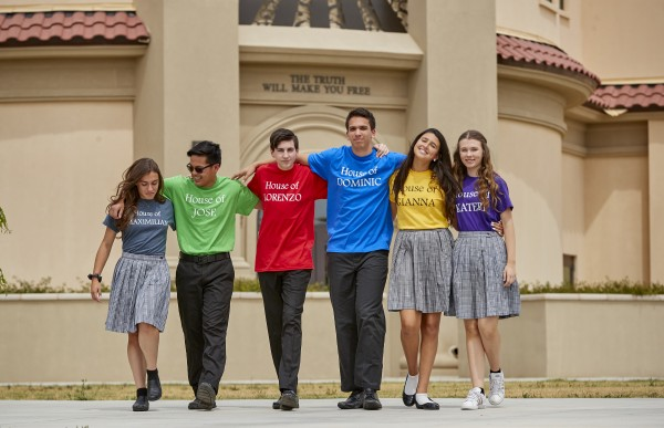Photo of Catholic high school students walking arm in arm