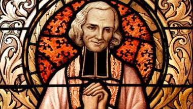 Stain glass window of St. John Vianney