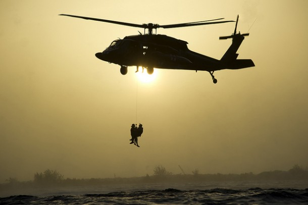 Photo of A Flight Medic being hoisted into a helicopter.
