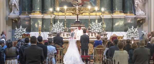Photo of wedding before the altar.