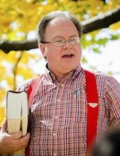 Picture of Dr. John Holmes holding a book
