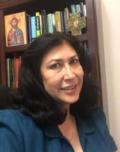 headshot of Gloria Zapiain in library